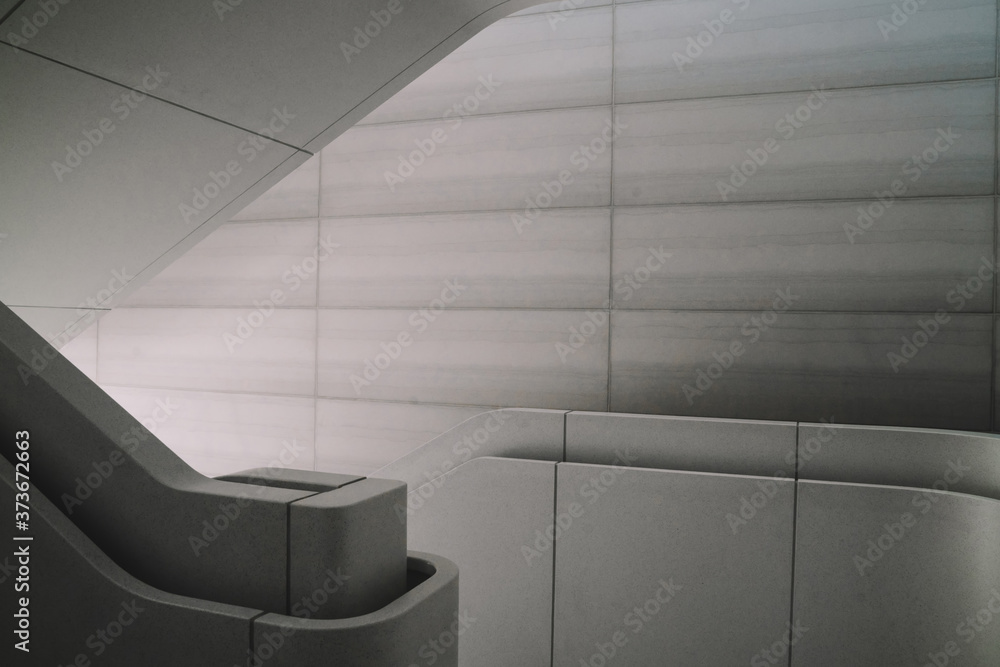 Modern interior design of concrete staircase with beautiful interior light. Contemporary architecture construction with clear space design