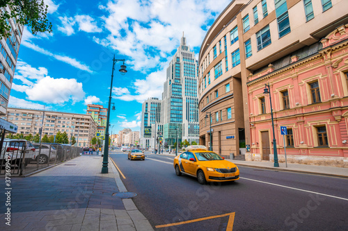Photo Moscow / Russia - 16 Aug 2020: Automobile stream and yellow taxi near the busine