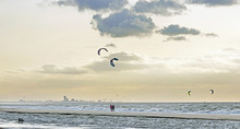 Autumn At A Windy Beach Near The Hague With Active Kite Surfers