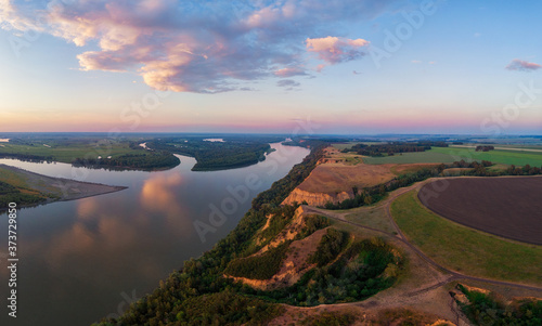 Obraz Aerial drone view of river landscape in sunny summer evening. Top view of siberian Ob river from high attitude in summer sunset. Panorama, bird's eye view - fototapety do salonu