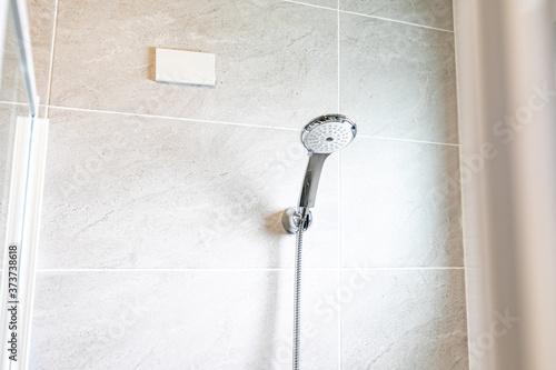 Fotografiet Shower head in the holder in a bathroom