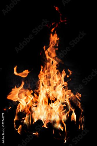 Fotografia Bonfire flame isolated on black background, close up