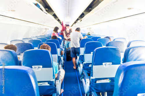 Fotografia Empty plane interior with few people and stewardess during coronavirus pandemia