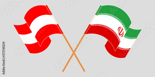 Crossed and waving flags of Iran and Austria Canvas