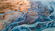 Leinwandbild Motiv A glacial rivers from above. Aerial photograph of the river streams from Icelandic glaciers. Beautiful art of the Mother nature created in Iceland. Wallpaper background high quality photo