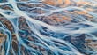 A glacial rivers from above. Aerial photograph of the river streams from Icelandic glaciers. Beautiful art of the Mother nature created in Iceland. Wallpaper background high quality photo