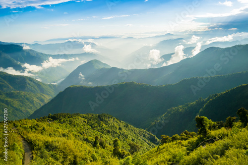 Huge himalaya mountains layer covered with fog and clouds Fototapet