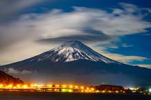 Japan. Lights Of Kawaguchiko City At The Foot Of Fuji. The Volcano Fuji. Tourism In Japan. An Active Volcano In Japan. Fuji On The Background Of The Cloudy Sky. Kawaguchiko Landscape. Travel To Asia.