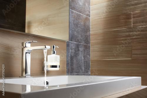 Fototapeta Bathroom water mixer. Water tap made of chrome material obraz