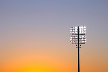 Football Stadium Lights At Sun...