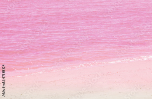 Photo Sea water and pink sand background