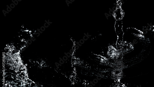 Fotografia, Obraz Splashes and drops of water are on a black background.
