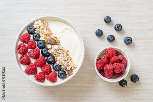 Leinwand Poster homemade yogurt bowl with raspberry, blueberry and granola