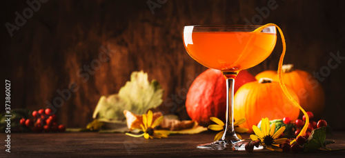 Obraz na plátně Satan whiskers, orange halloween cocktail with gin, vermouth, juice and liquor,