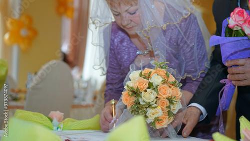 senior bride affix signature with pen in golden wedding event Canvas Print