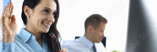 Photo Call center operator greets interlocutor for an online call