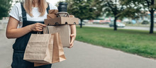Contactless Delivery. Girl Courier With Food Takeaway Zero Waste Paper Packaging Delivers Groceries. Concept Takeaway Take-out, Carry-out  Stay Home