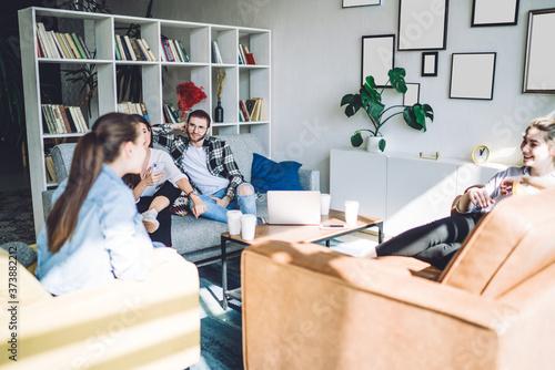 Cheerful young people communicating at home Slika na platnu