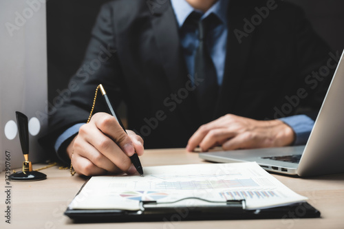 Fototapeta Close up business man signing contract making a deal, classic business success c