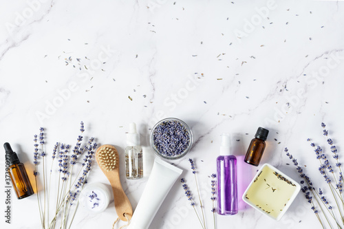 Fotografering Variety of organic lavender cosmetics on white background top view