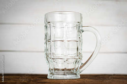 Empty beer pint, mug on wooden table. Close up Canvas Print