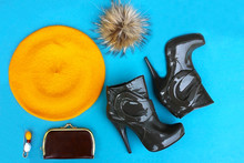 Fashionable Collage Of Accessories For A Woman. Yellow Beret, Half-boots With Heels, Wallet, Brooch And Fur Pompom.