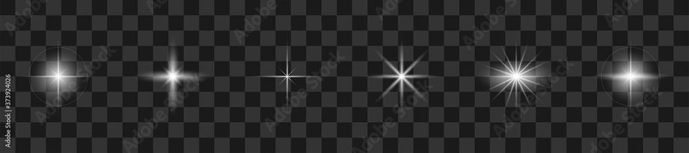 Fototapeta Glare light collection. Vector illustration. Realistic white stars with glare.