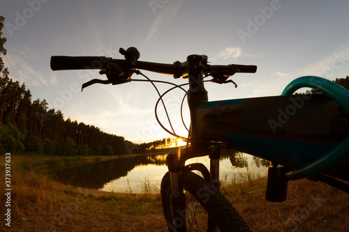 Bicycle on nature side Fotobehang