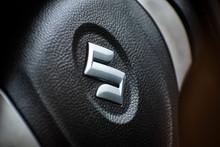 20/07/2020- Kerala, India: Suzuki Metallic Chrome Plated Logo Closeup On Steering Wheel Of Suzuki Wagon R Car In Kerala, India.