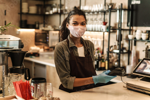 Fototapety, obrazy: Woman barista wearing medical face mask