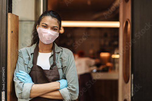 Fotografering Woman cafe owner with face mask