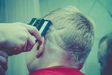 Haircut Of A European Blond Bo...