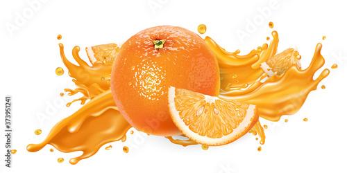 Fotografia Splash of fruit juice and fresh orange.