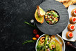 Food background. Dishes of European cuisine in plates. Top view. Free space for text.