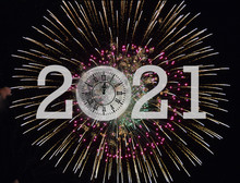 Full Moon Clock Showing Midnight Time For New Year 2021 On Fireworks Background