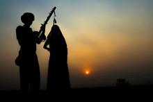 Silhouette Of Folk Musicians P...