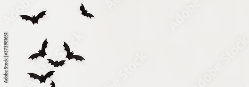 Tableau sur Toile Halloween and decoration concept - black paper bats flying over white background