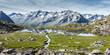 canvas print picture - Bergsee Panoramabild mit Spiegelung im vom Wollgras umrandeten Gebirgssee im Zillertal