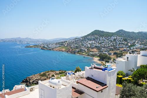 Obraz white holiday villas houses on resort with sea city view - fototapety do salonu