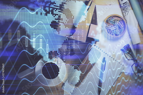 Double exposure of forex graph drawing and work table top veiw Canvas Print