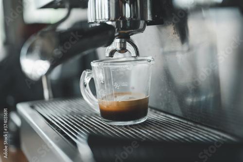 Fotografiet Espresso coffee pouring from espresso machine