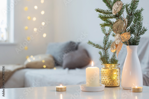 Christmas decorations with burning candles in white interior Canvas Print