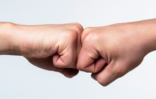 Man Giving Fist Bump. Team Concept. Hands Of Man People Fist Bump Team Teamwork, Success. People Bumping Their Fists Together, Arms. Friendly Handshake, Friends Greeting