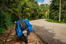 Solo Traveler Loaded Bike With Isolated Road And Amazing Background