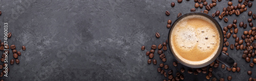 Horizontal banner with cup of coffee and coffee beans on dark stone background Fotobehang