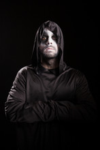 Portrait Of Grim Reaper With Hands Crossed Isolated Over Black Background. Halloween Costume.