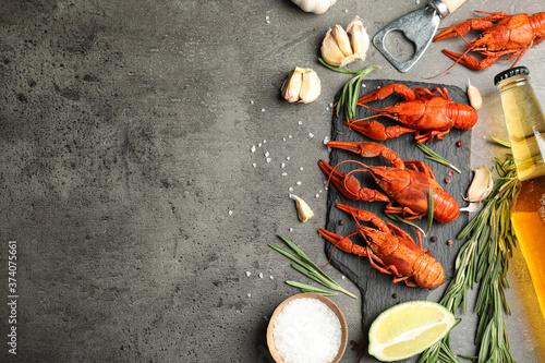 Fényképezés Flat lay composition with delicious red boiled crayfishes on black table