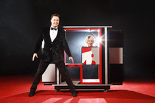 Magician Performer And Beauty Girl Show Trick With Box Illusion On The Ring In Circus