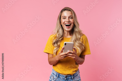 Fotografie, Tablou Positive young woman using mobile phone
