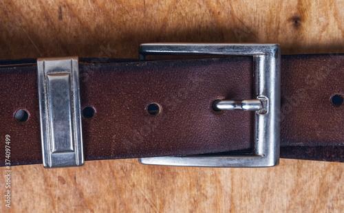 Fotografie, Obraz Male leather belt on the table